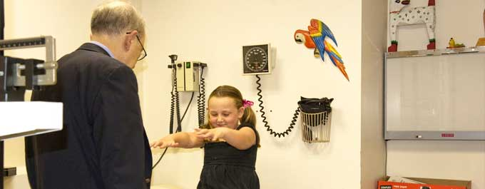Pediatric neurologist at North Shore Physicians Group works with a patient