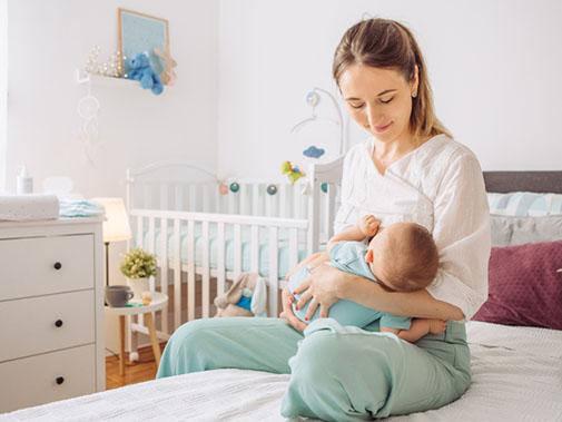 young mother breastfeeding her newborn