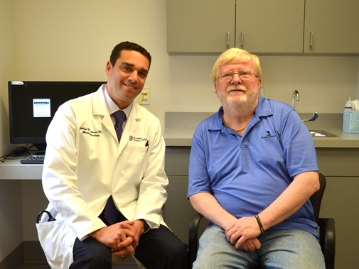 gastroenterology physician with patient