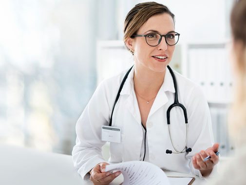Friendly doctor smiling at patient