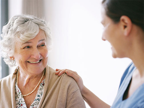 Patient smiling at her doctor