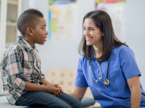 Doctor speaking to her young patient