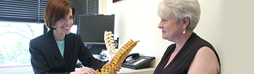 North shore physician speaks with rehabilitation patient