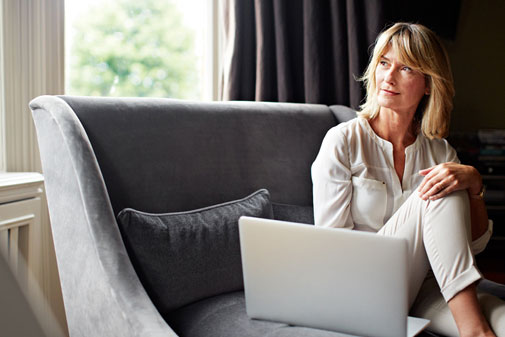 older woman enjoying a mindfulness meditation session online